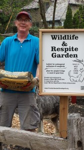 Chris Bushnell with newly installed garden sign
